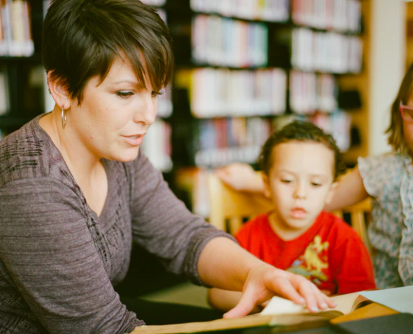 teacher reading to a student